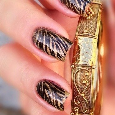 Black and Gold Zebra nail art by Debbie