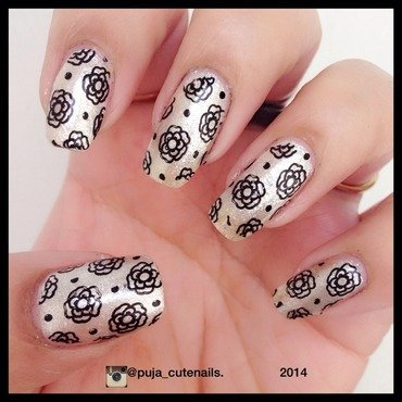 Simple flower nails nail art by Puja Malhotra
