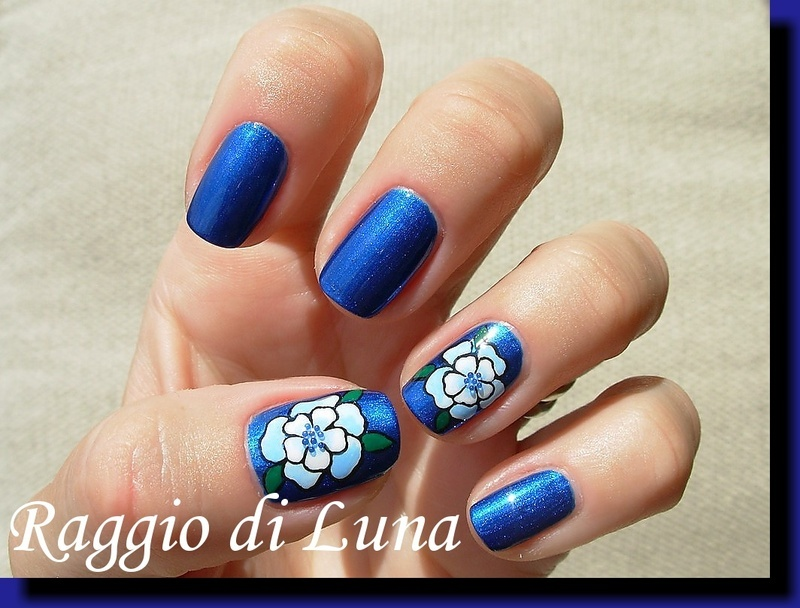 Light blue flower on dark blue nail art by Tanja