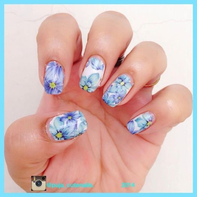 Blue flowers nail art nail art by Puja Malhotra