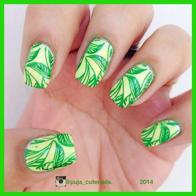 Tropical leaves nail art nail art by Puja Malhotra