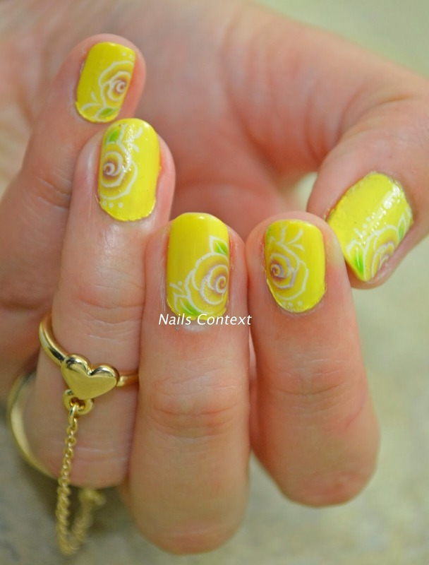 Yellow florals nail art by NailsContext