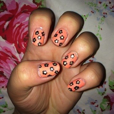 Matte flowers with neon nail art by Chloe Lewis