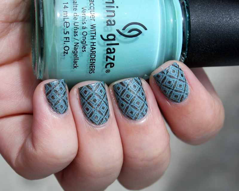 Black and turquoise pattern nail art by Moriesnailart