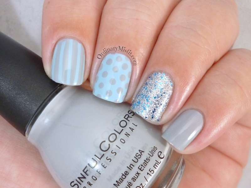 Blue and grey skittle nail art by Michelle