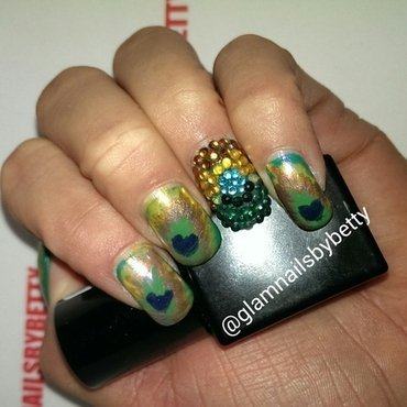 Glam peacock nail art by Betty