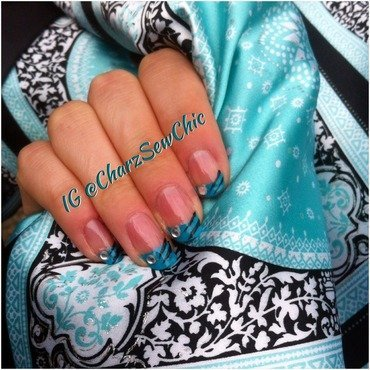 Turquoise stripes and tips nail art by Charlotte Speller
