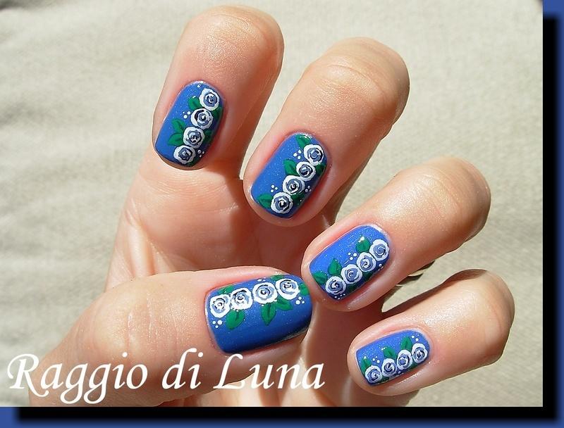 White & blue roses on denim blue nail art by Tanja