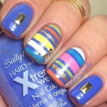 Blue coloured stripes & gold studs nail art by Nicole