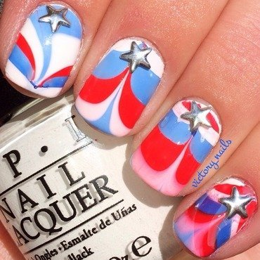 Red, white & blue watermarble nail art by Nicole