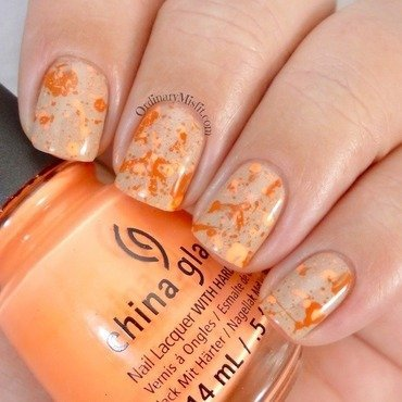 Orange splatter on nude nail art by Michelle