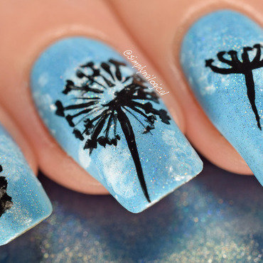 Dandelion silhouettes over a holo blue sky nail art by simplynailogical