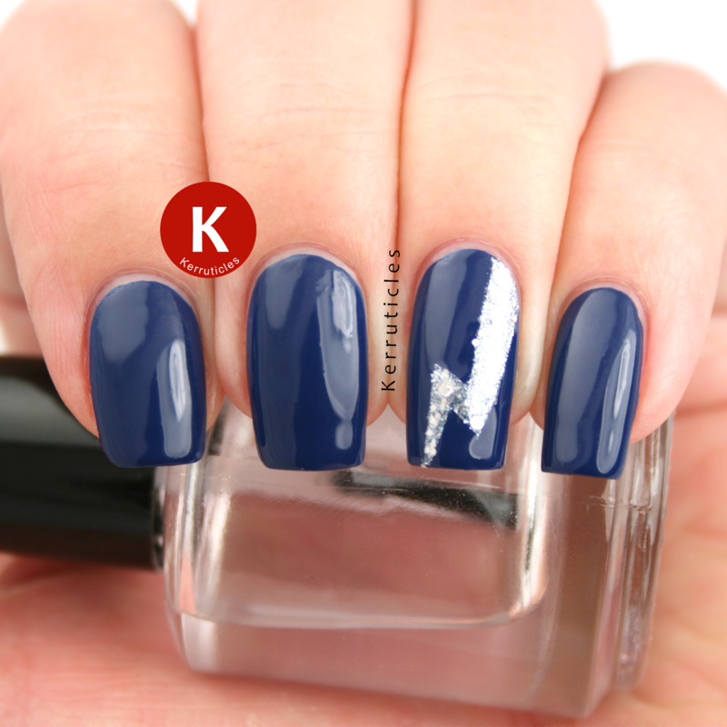Navy with silver glitter lightning bolt nail art by Claire Kerr