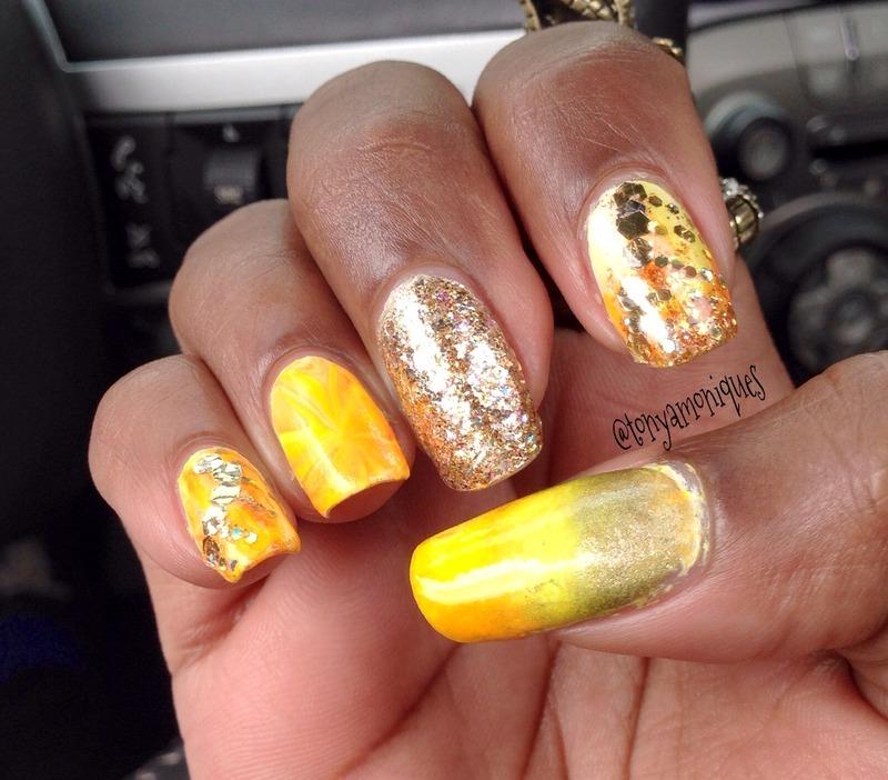 Gold Starburst nail art by Tonya Simmons