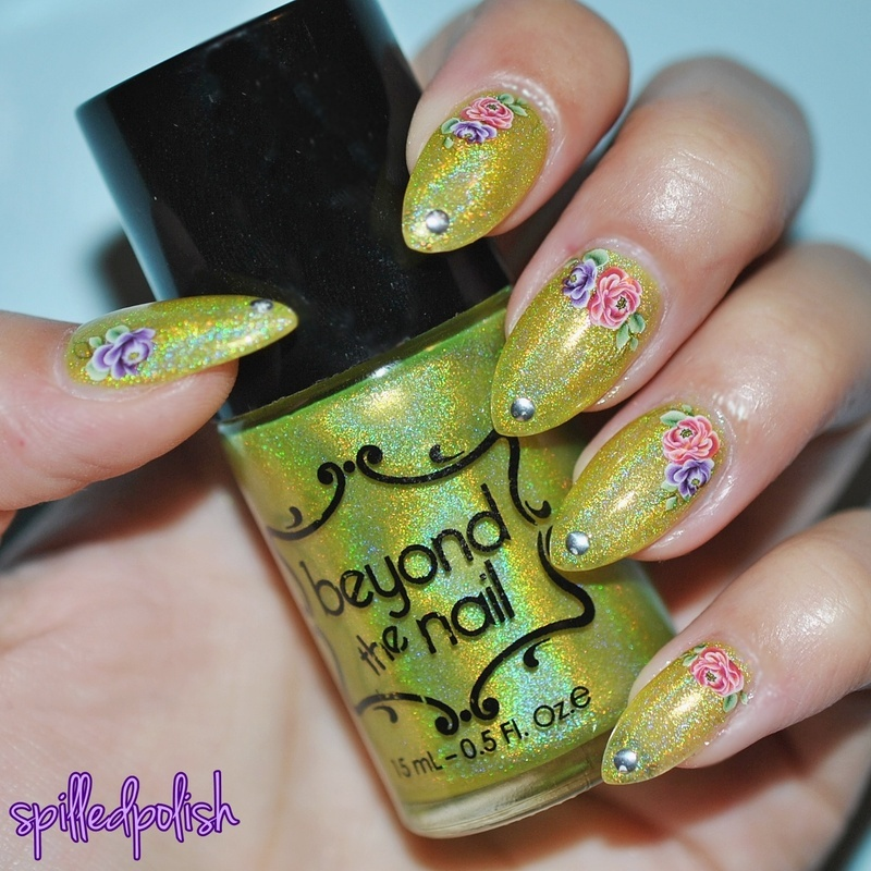 Pink and Purple Flowers on a Holographic Yellow Base nail art by Maddy S