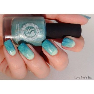 Teal half-moon design nail art by Love Nails Etc