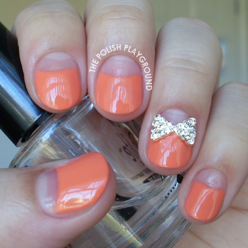 Negative Space Half Moon Mani with Bow Stud nail art by Lisa N