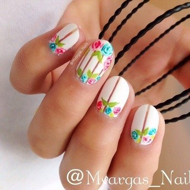 Stripes and flowers nail art by Massiel Pena