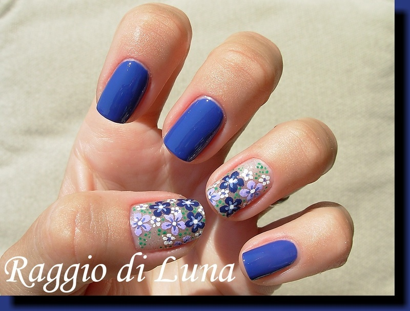 Blooming flowers on blue nail art by Tanja