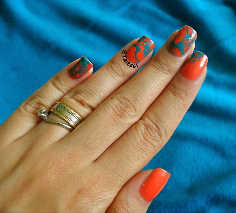Orange and teal water marble nail art by Teo