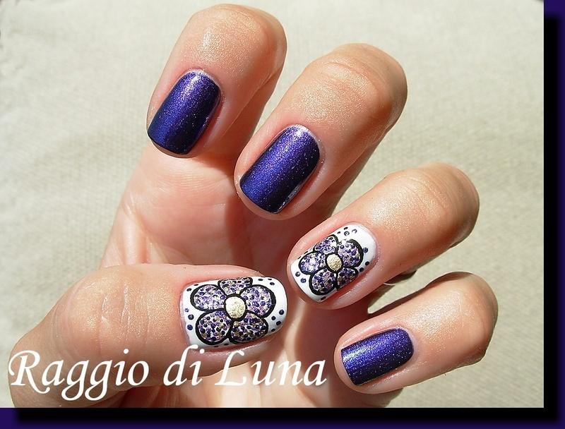 Dotty flower on purple nail art by Tanja