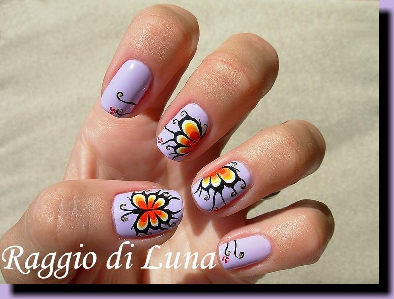 Butterfly on light purple nail art by Tanja