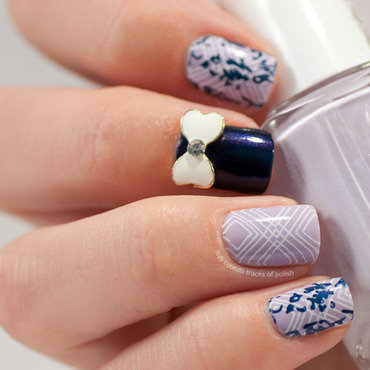 Purple skittlette with 3D bow nail art by Zara TracesOfPolish