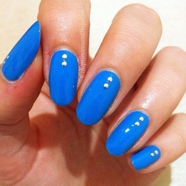 Blue studs nail art by Alexandra
