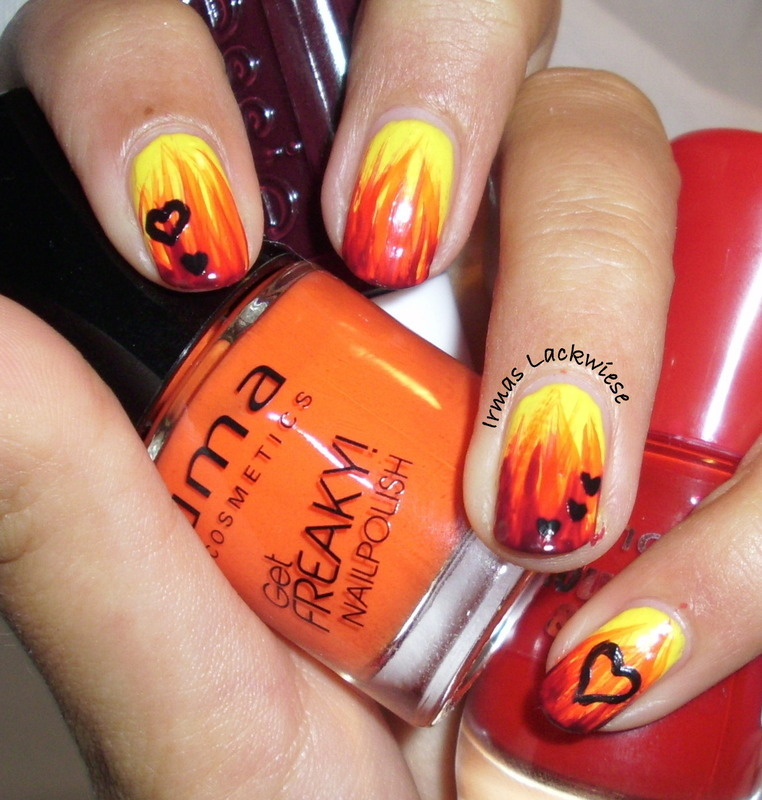 flames with hearts nail art by irma