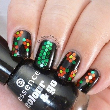 Glittery flowers nail art by Michelle