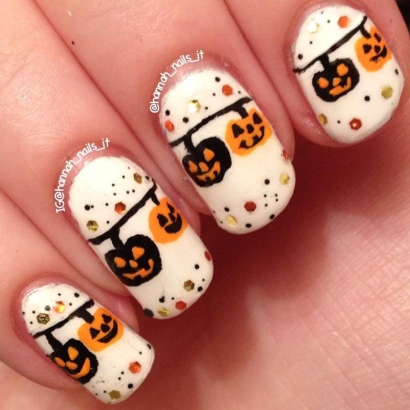 Hanging pumpkins nail art by Hannah