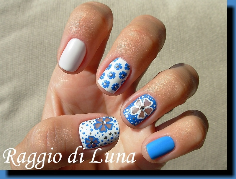 Sky blue & white flowers skittlette nail art by Tanja