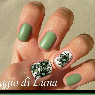 Green flowers with green rhinestones nail art by Tanja
