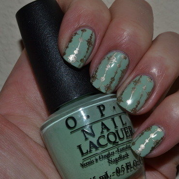 Mint green with gold accent nail art by Svetlana Tsad