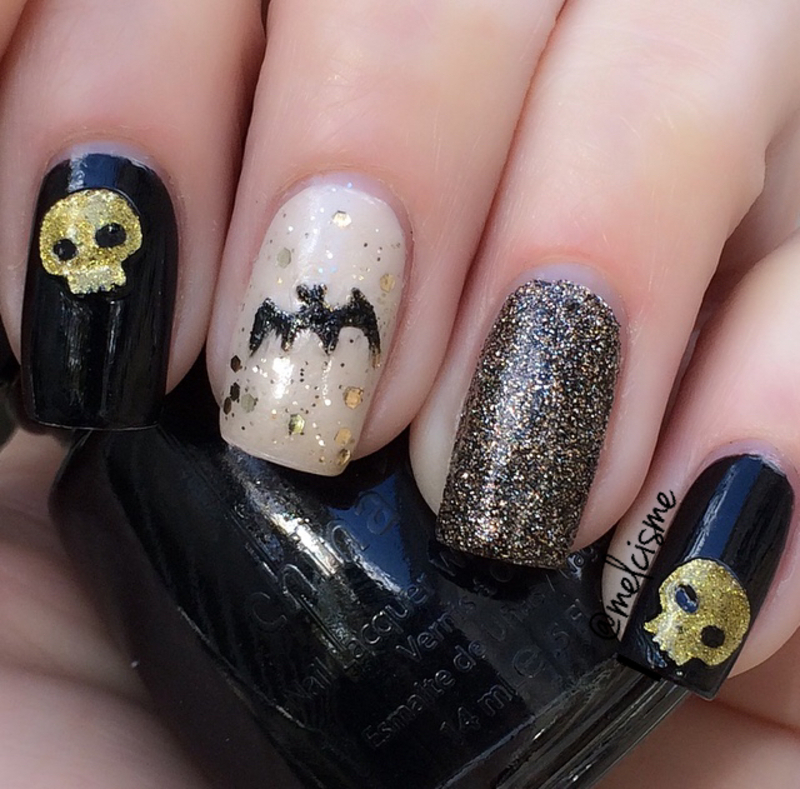 Black & Gold Halloween nail art by Melissa