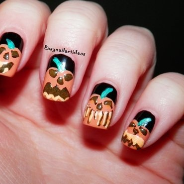 Crazy Pumpkins  nail art by Easynailartideas