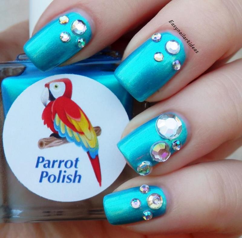 Blue Macaw nail art by Easynailartideas