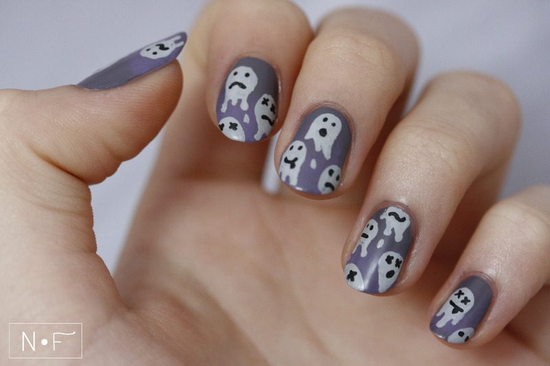 Dripping emojis nail art by NerdyFleurty