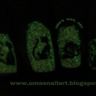 Glowing Kitties... nail art by Uma mathur