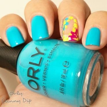 Orly 20skinny 20dip 20with 20a 20negative 20space 20flower 20decorated 20accent 20mani thumb370f
