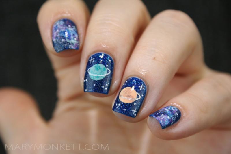 Planète et galaxie nail art by Mary Monkett