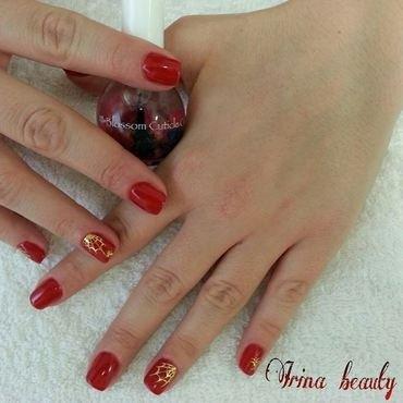 Sexy red nail polish and stickers of cobwebs nail art by Irina