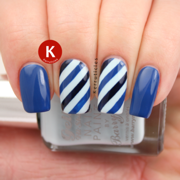 Diagonal blue stripes nail art by Claire Kerr