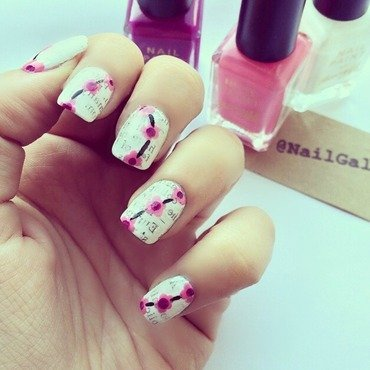 Newspaper mani with a twist nail art by NailGals