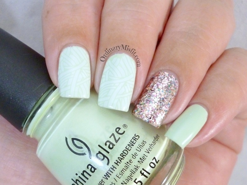 Stamped mint and glitter nail art by Michelle