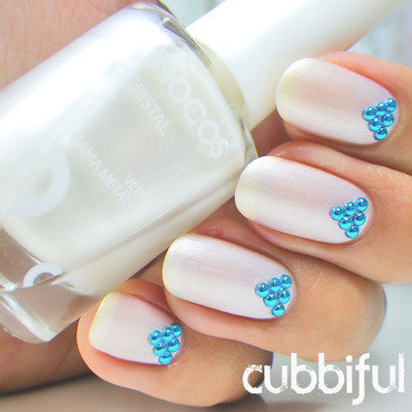Elegant Pearly Nails with Blue Studs nail art by Cubbiful