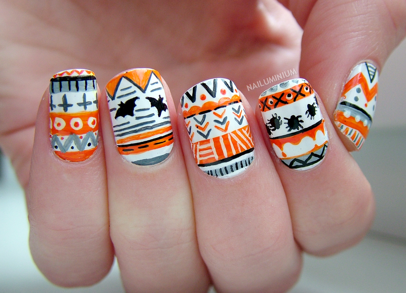 Halloween Tribal nail art by Margee C.
