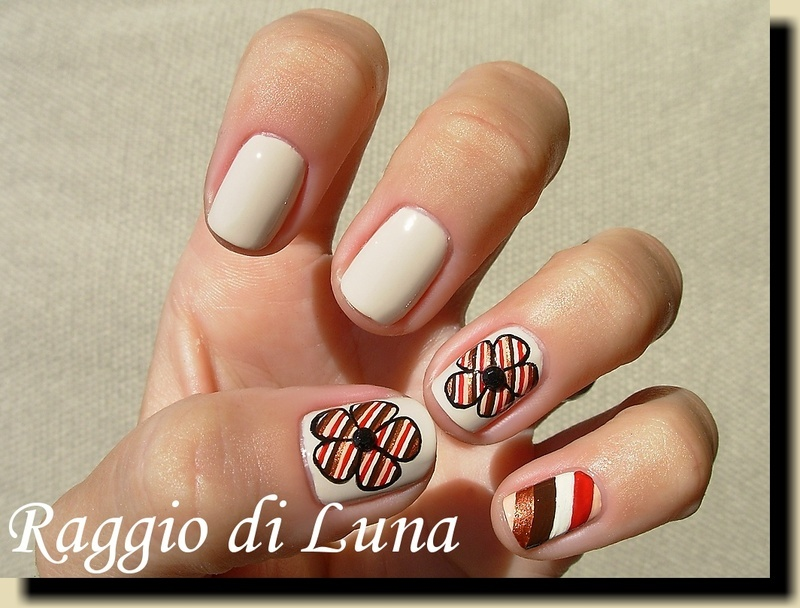 Striped flower nail art by Tanja
