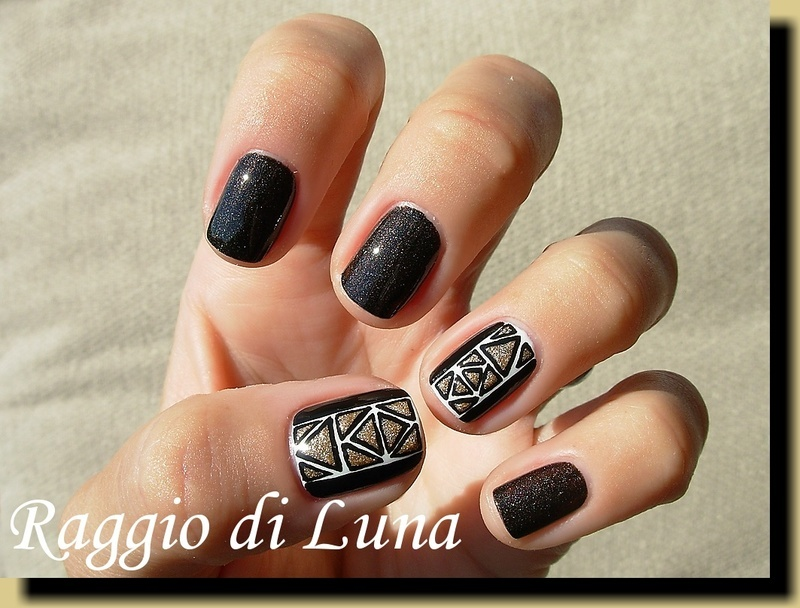 Golden triangles nail art by Tanja