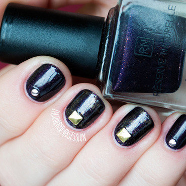 Studded aubergine nail art by Lacquered Obsession